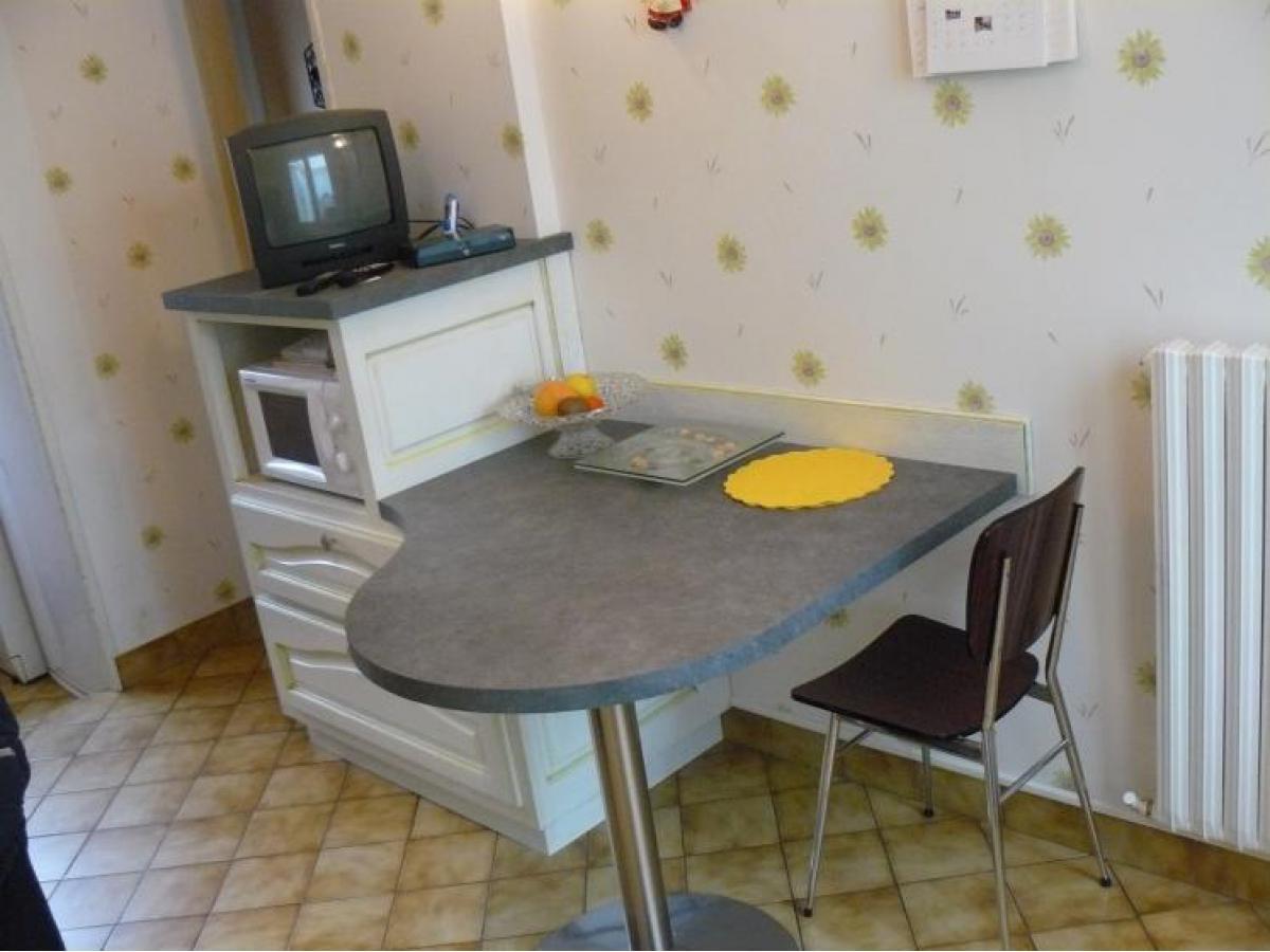 Création d'une table accolée à un meuble